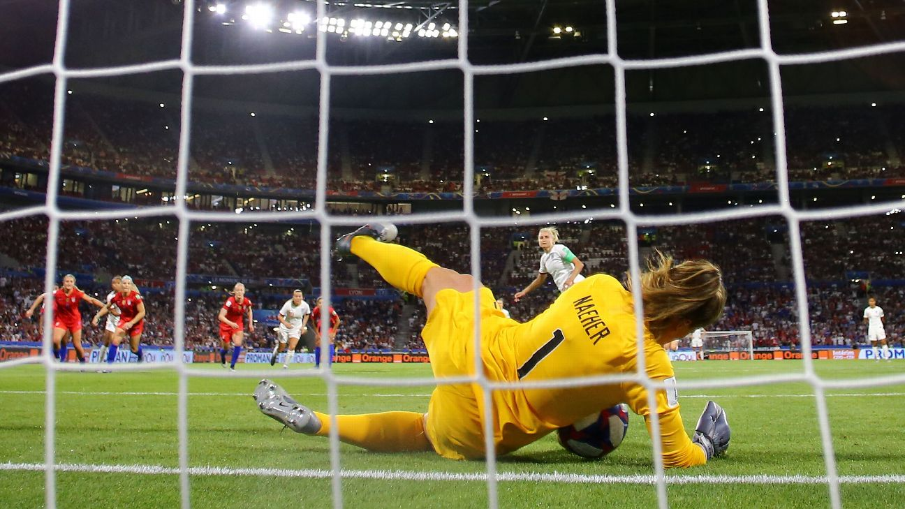 U.S. goalkeeper Alyssa Naeher saves a penalty kick from England's Steph Houghton.