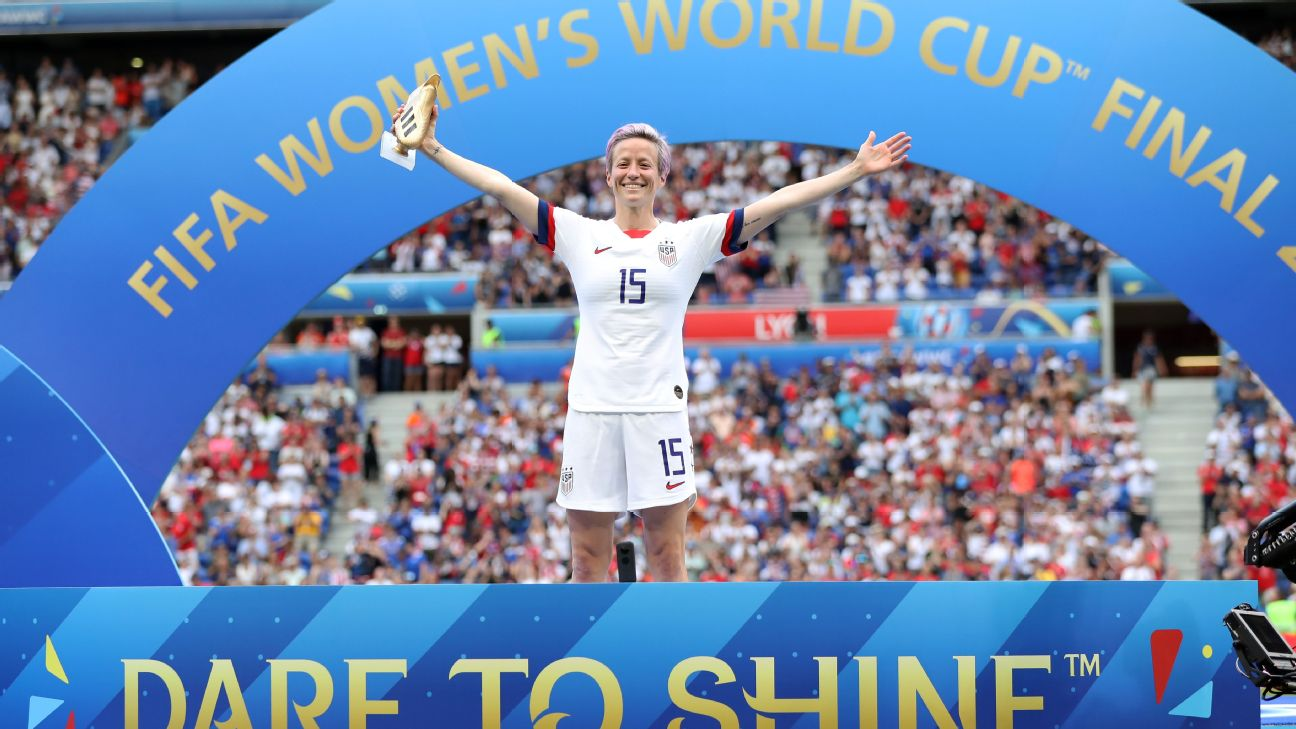 Megan Rapinoe celebrates with the Golden Boot award, presented to the Women's World Cup's top scorer.