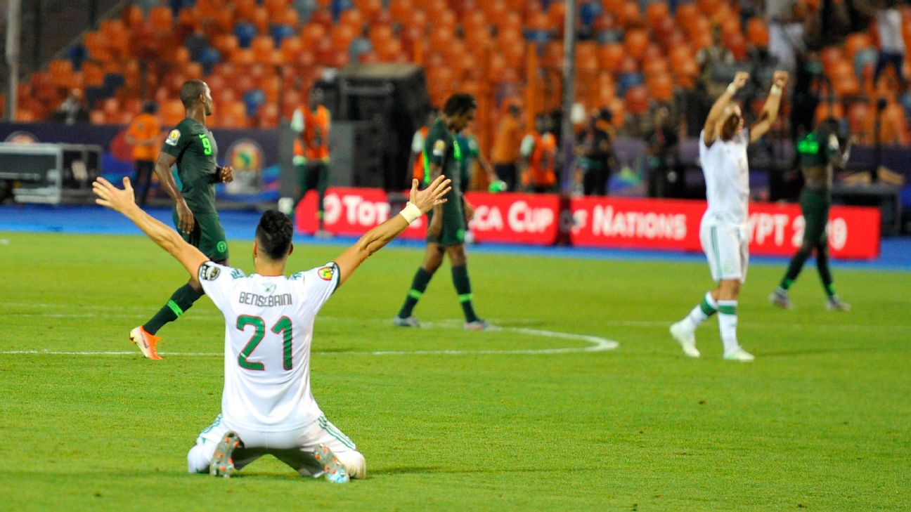 Algeria's players celebrate their winning goal during the 2019 Africa Cup of Nations (CAN) Semi-final football match