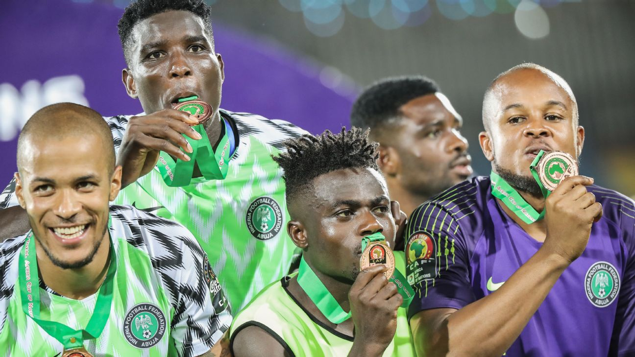 Nigeria players celebrate after winning the Africa Cup of Nations third-place game against Tunisia.