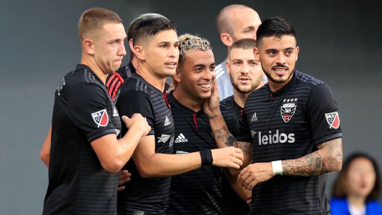 D.C. United players celebrate after scoring a goal against FC Cincinnati.