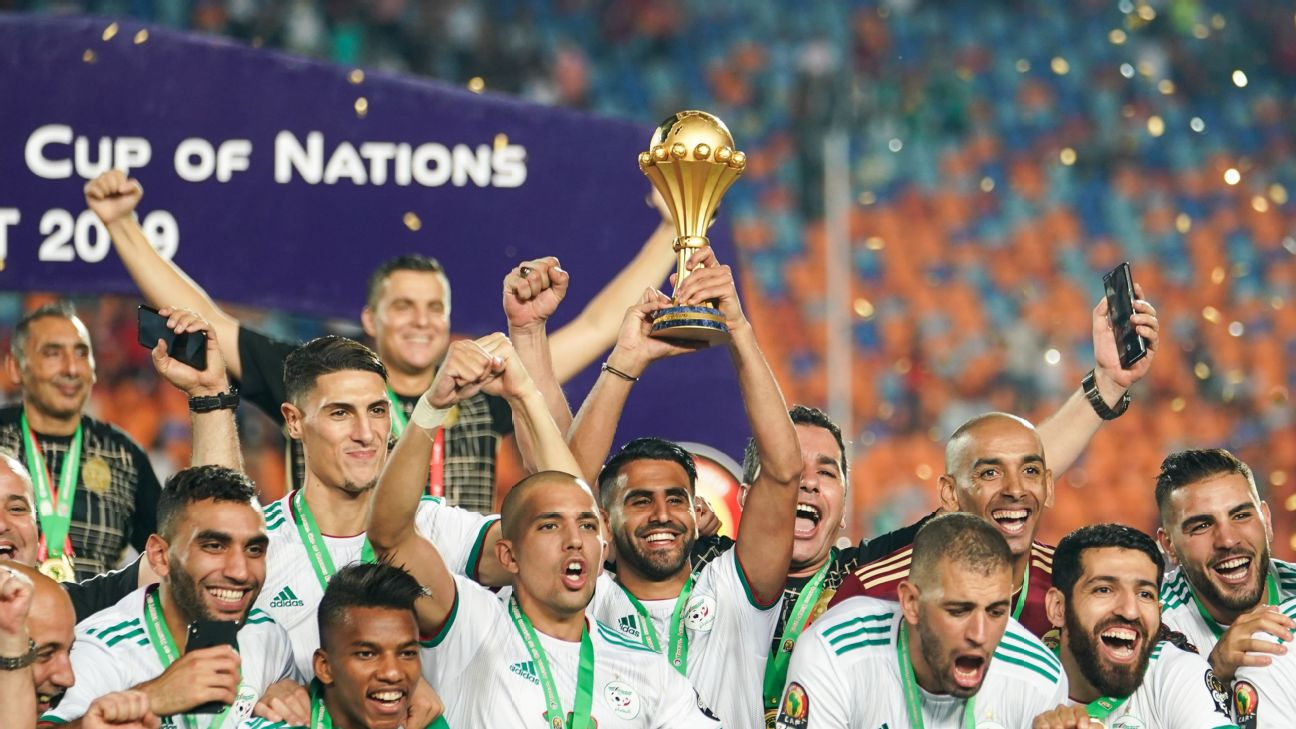Riyad Mahrez holds aloft the trophy after captaining Algeria to win the CAF Africa Cup of Nations.