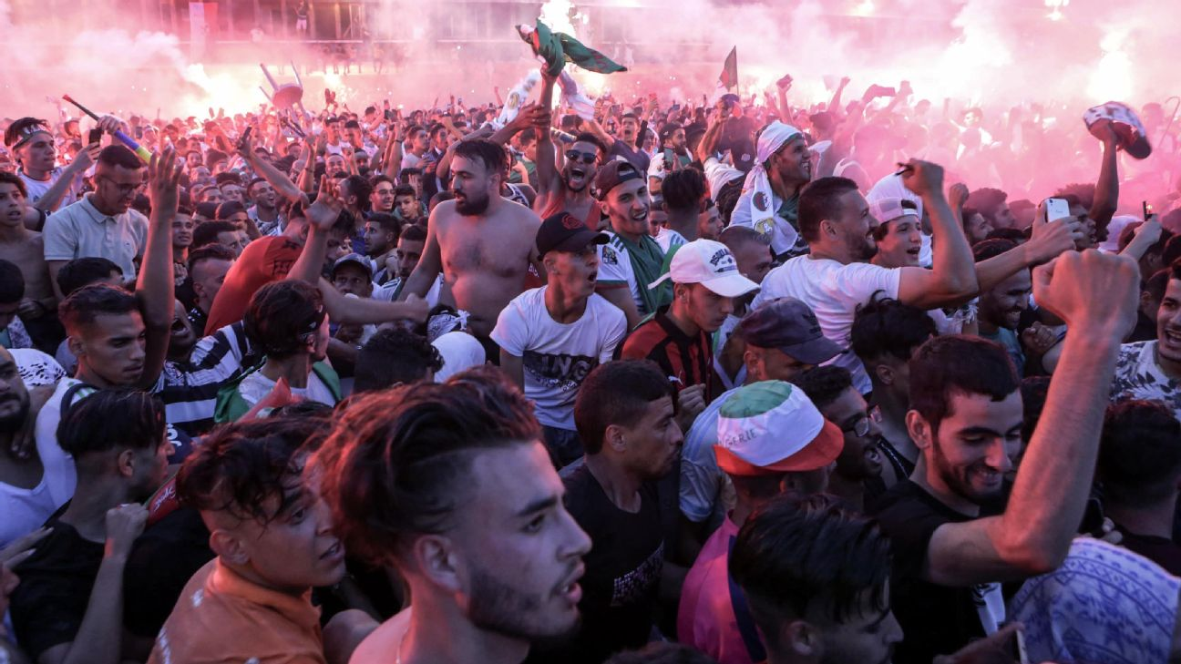 Algeria national soccer team supporters celebrate on the streets