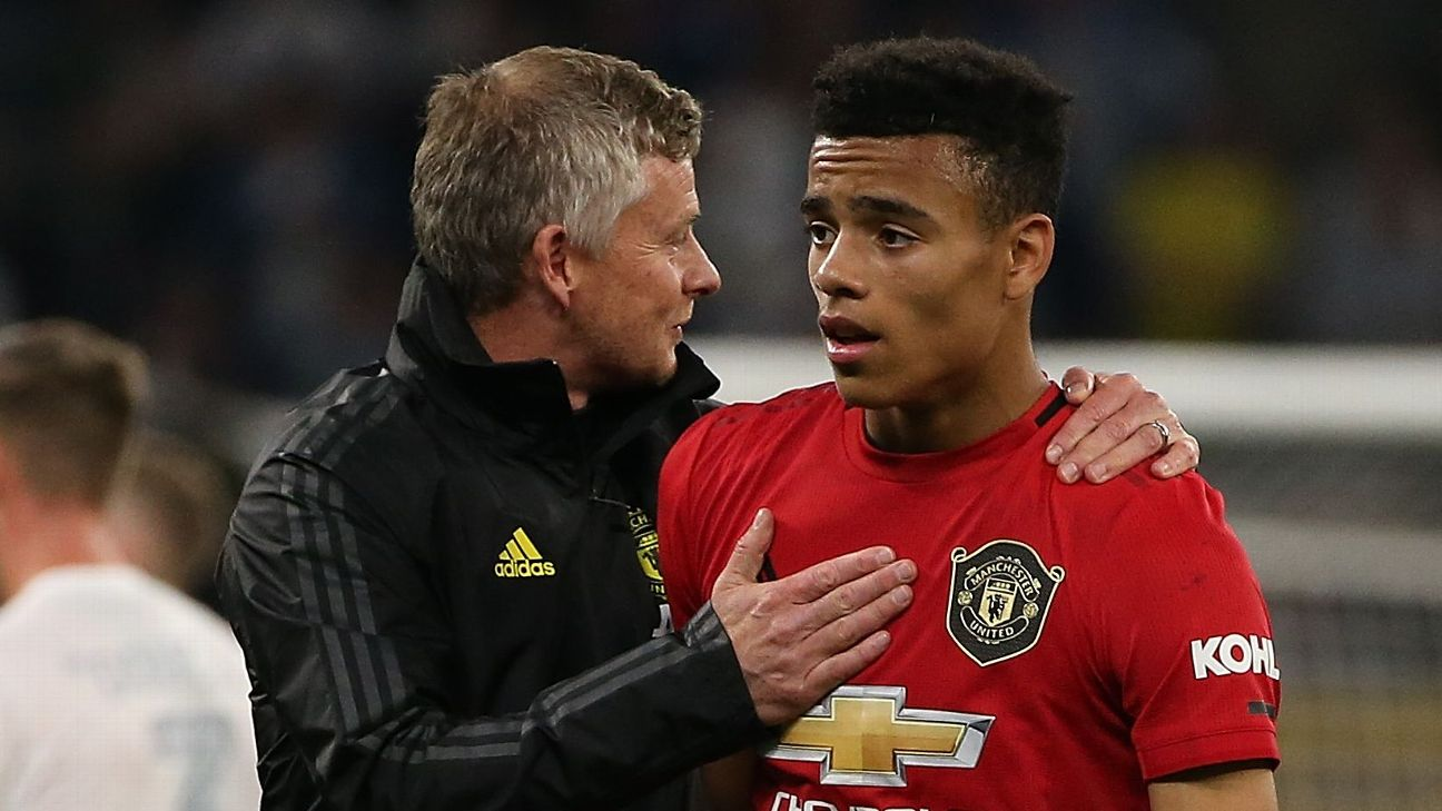 Ole Gunnar Solskjaer manager of Manchester United talks with Mason Greenwood