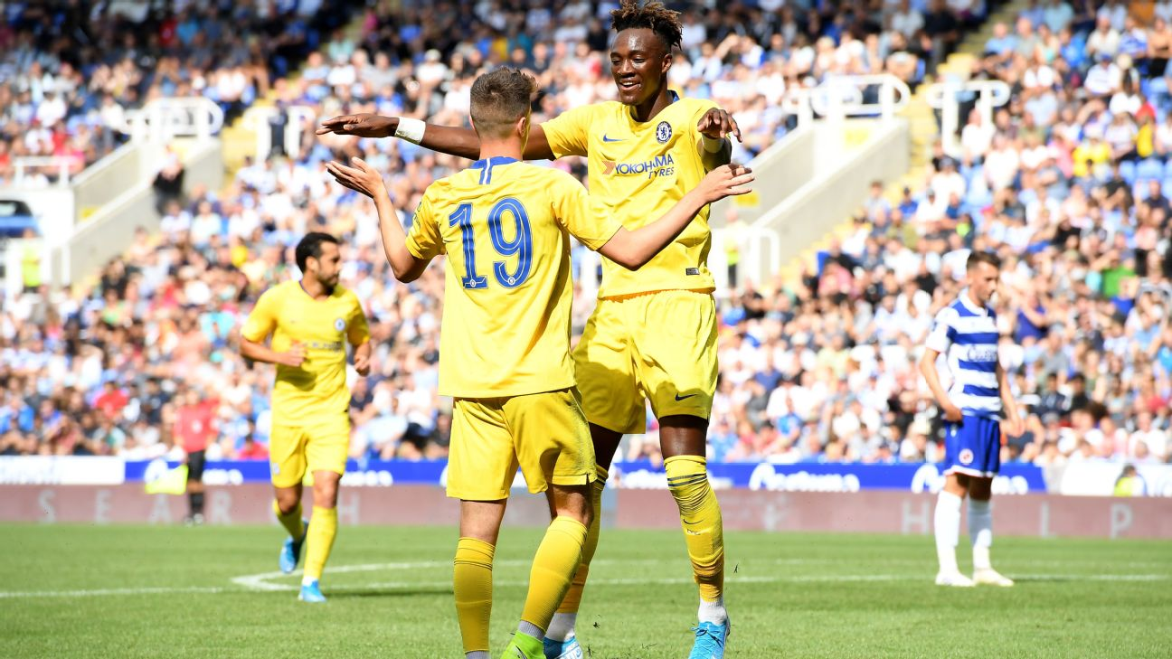 Mason Mount of Chelsea celebrates after scoring his team's third goal with Tammy Abraham