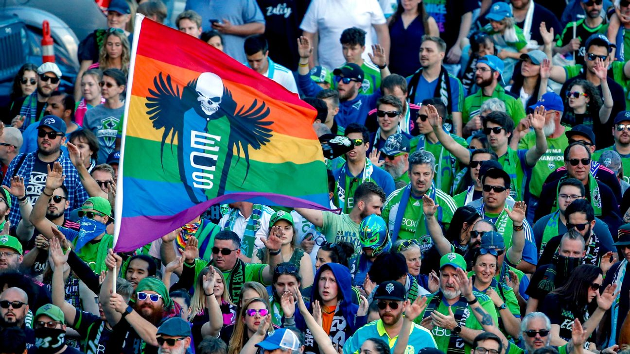 Seattle Sounders fans march to the match before an MLS match against the Vancouver Whitecaps.