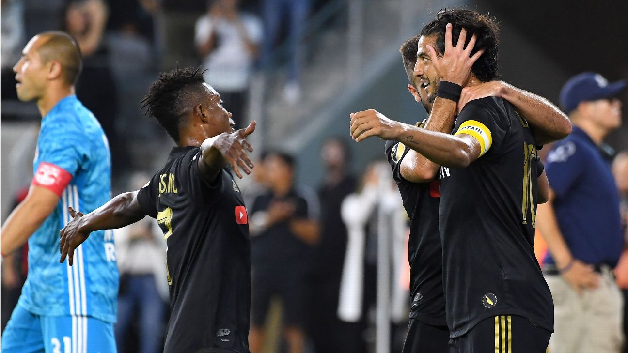 Carlos Vela, right, celebrates with teammates after scoring a goal for LAFC against the New York Red Bulls.