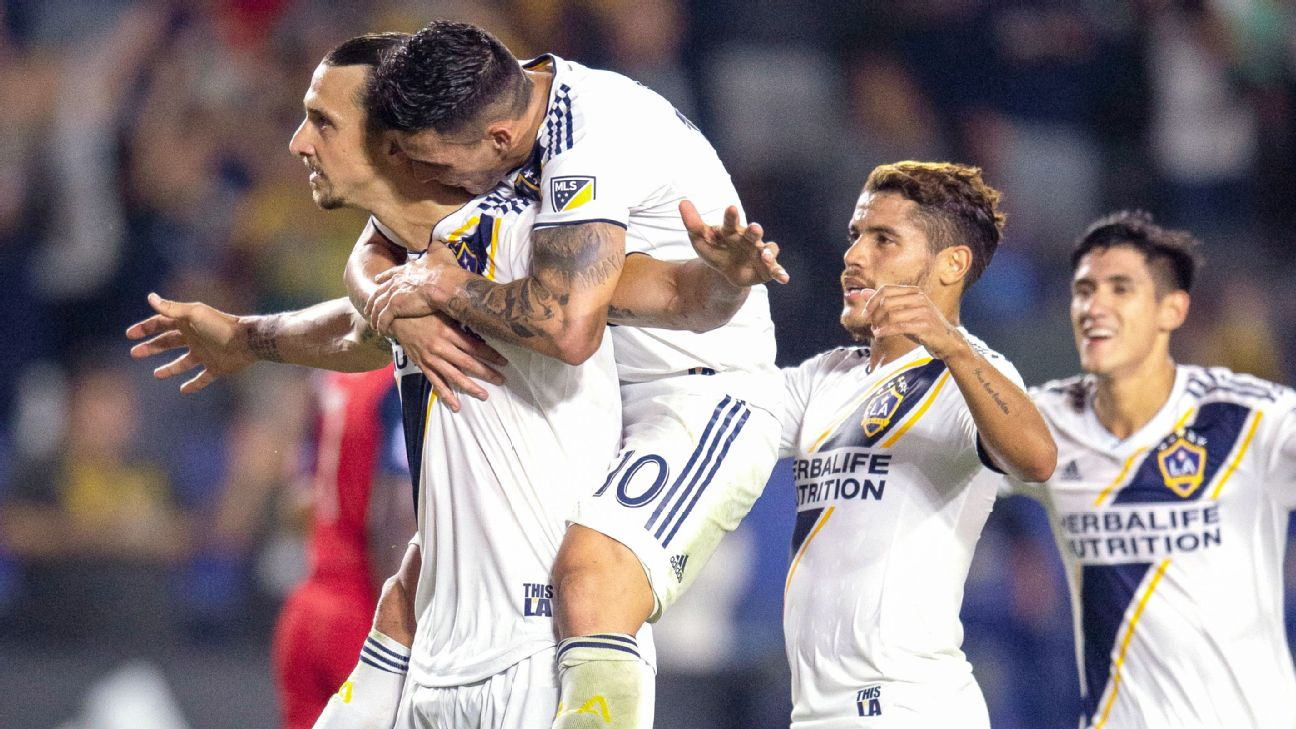 Zlatan Ibrahimovic and Cristian Pavon celebrate during the LA Galaxy's MLS win over FC Dallas.
