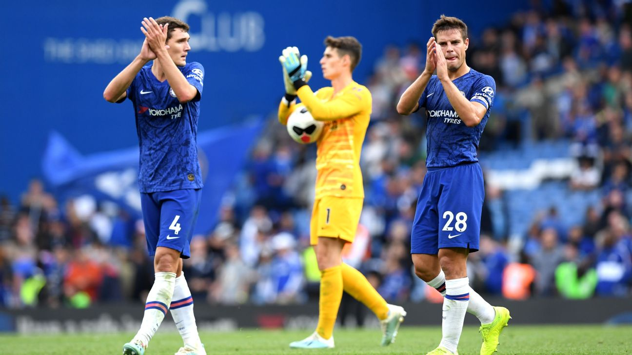 Andreas Christensen and Cesar Azpilicueta applaud fans after Chelsea's Premier League draw with Leicester City.