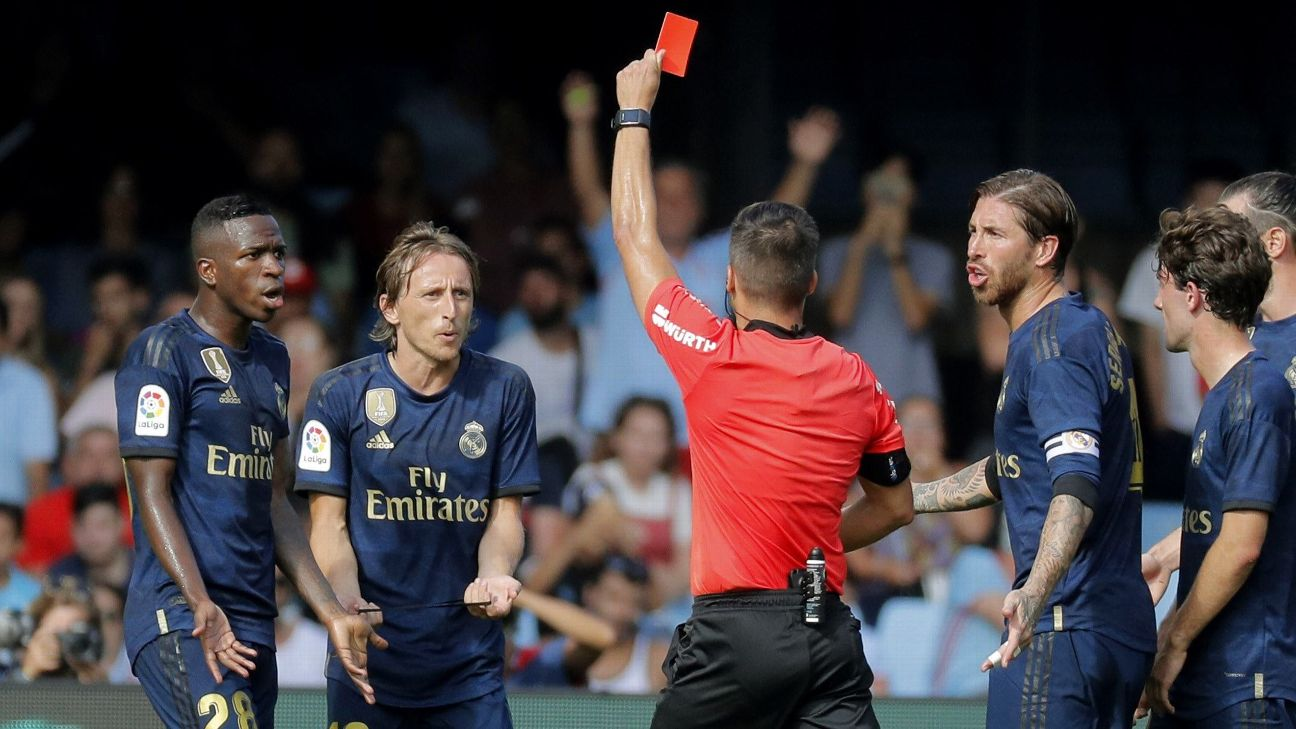 Luka Modrić (second from left) was shown a straight red card for the first time in his senior career during Real Madrid's win at Celta Vigo.