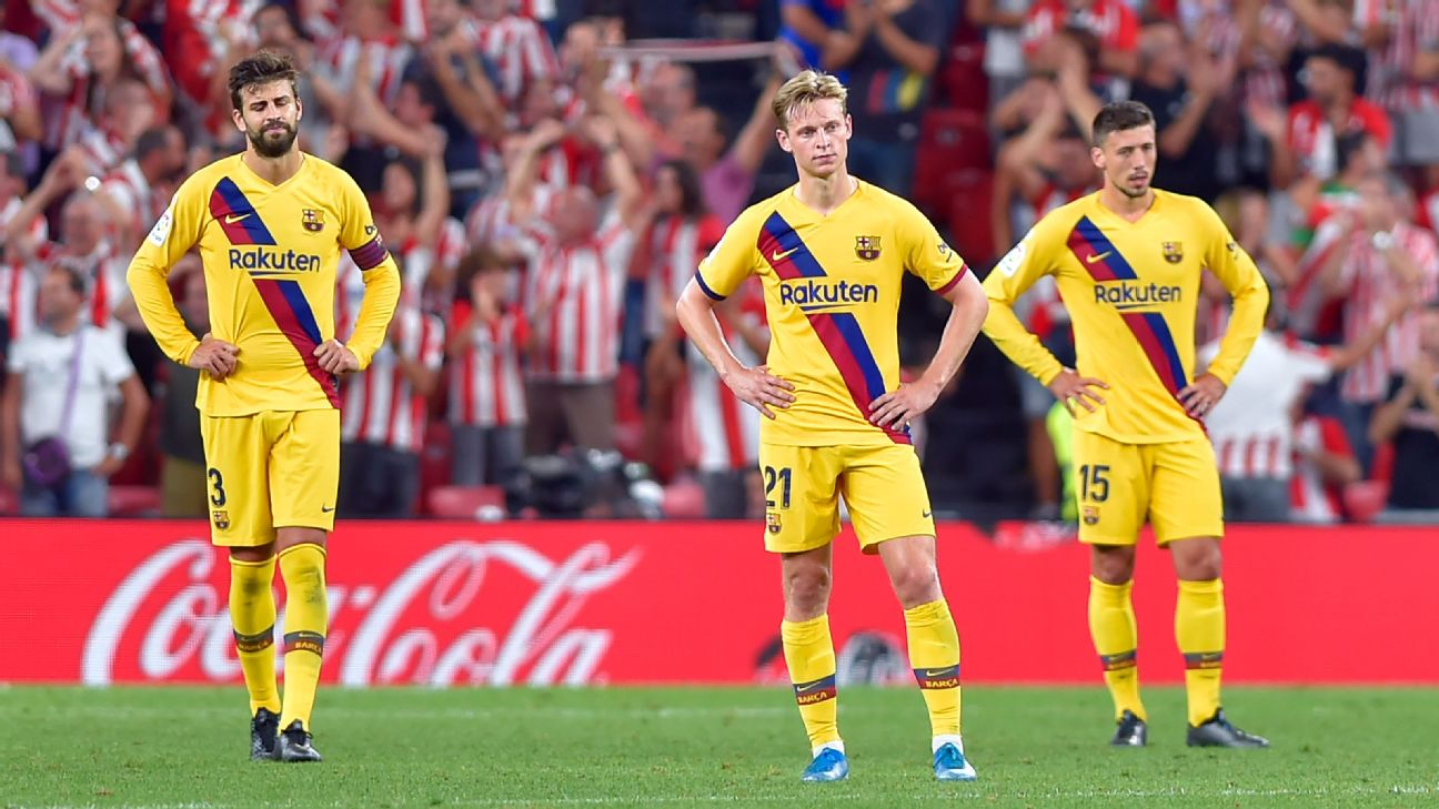 Barcelona players react during their La Liga loss to Athletic Bilbao.