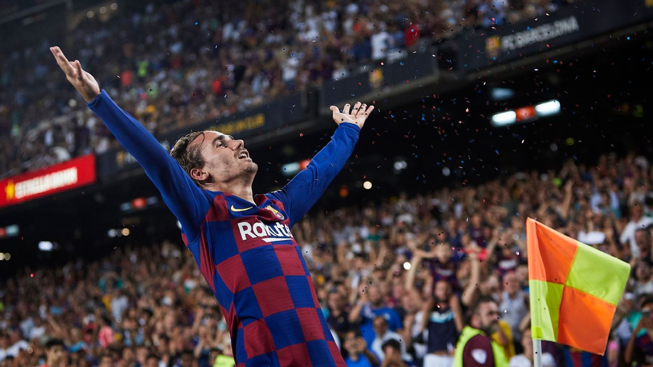 Antoine Griezmann celebrates after scoring in Barcelona's La Liga win over Real Betis.