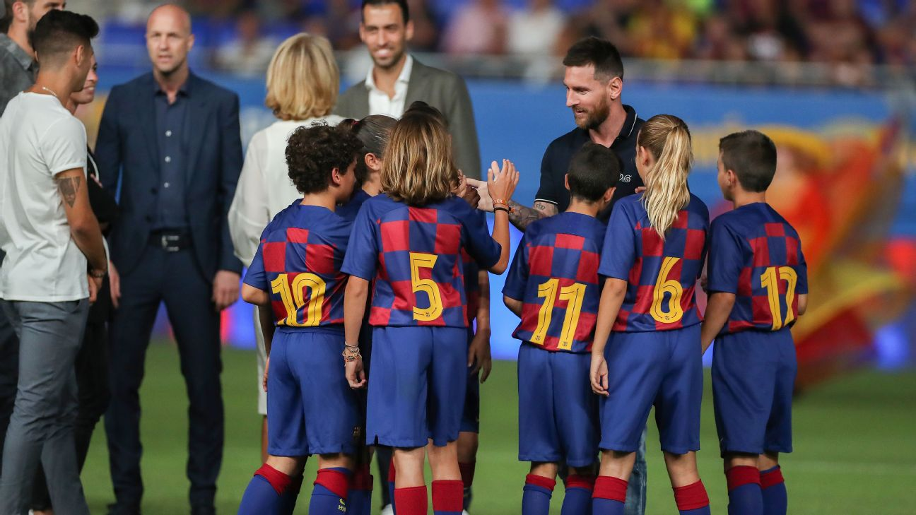 Lionel Messi shakes hands with Barcelona youth players at the opening of the brand new Johan Cruyff Stadium.