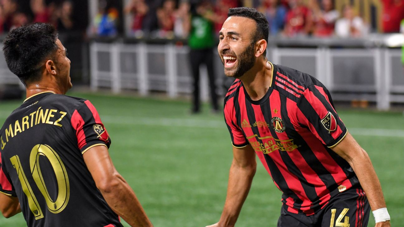 Atlanta United players Justin Meram, right, and