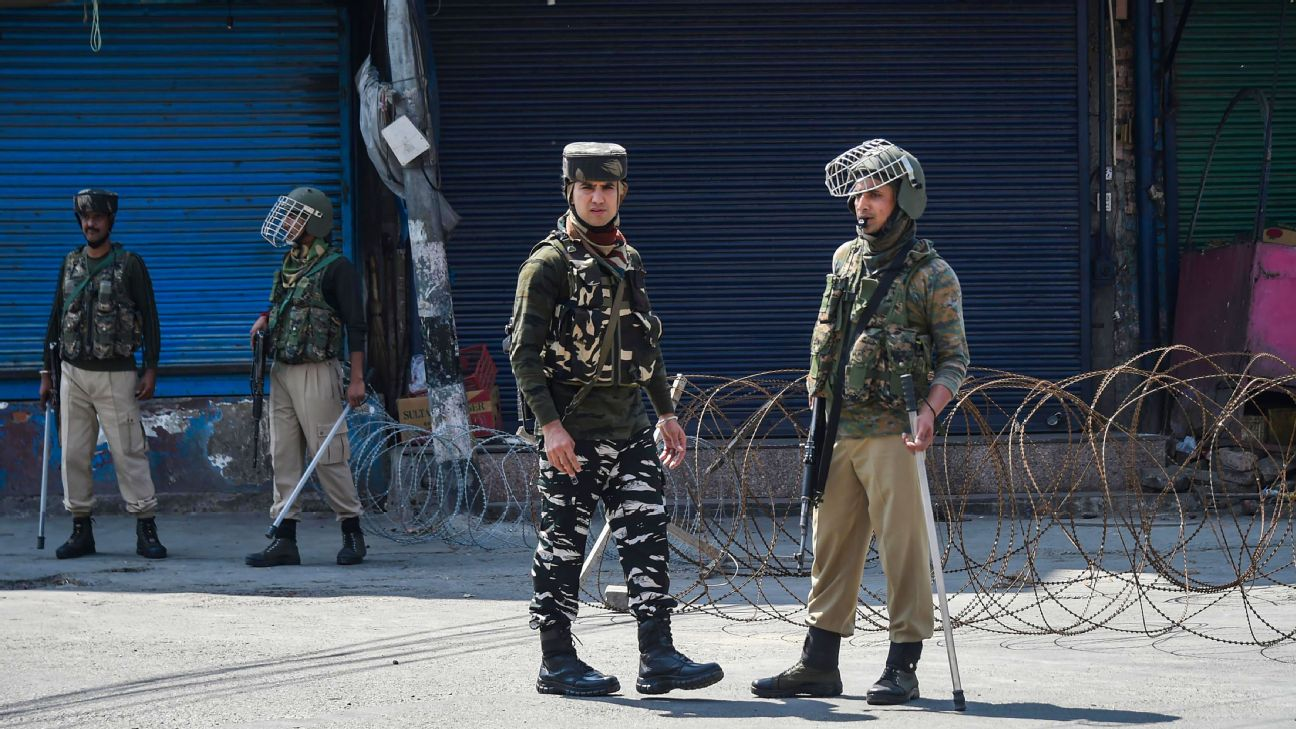 Security personnel stand guard during restrictions in Srinagar on September 4, 2019.