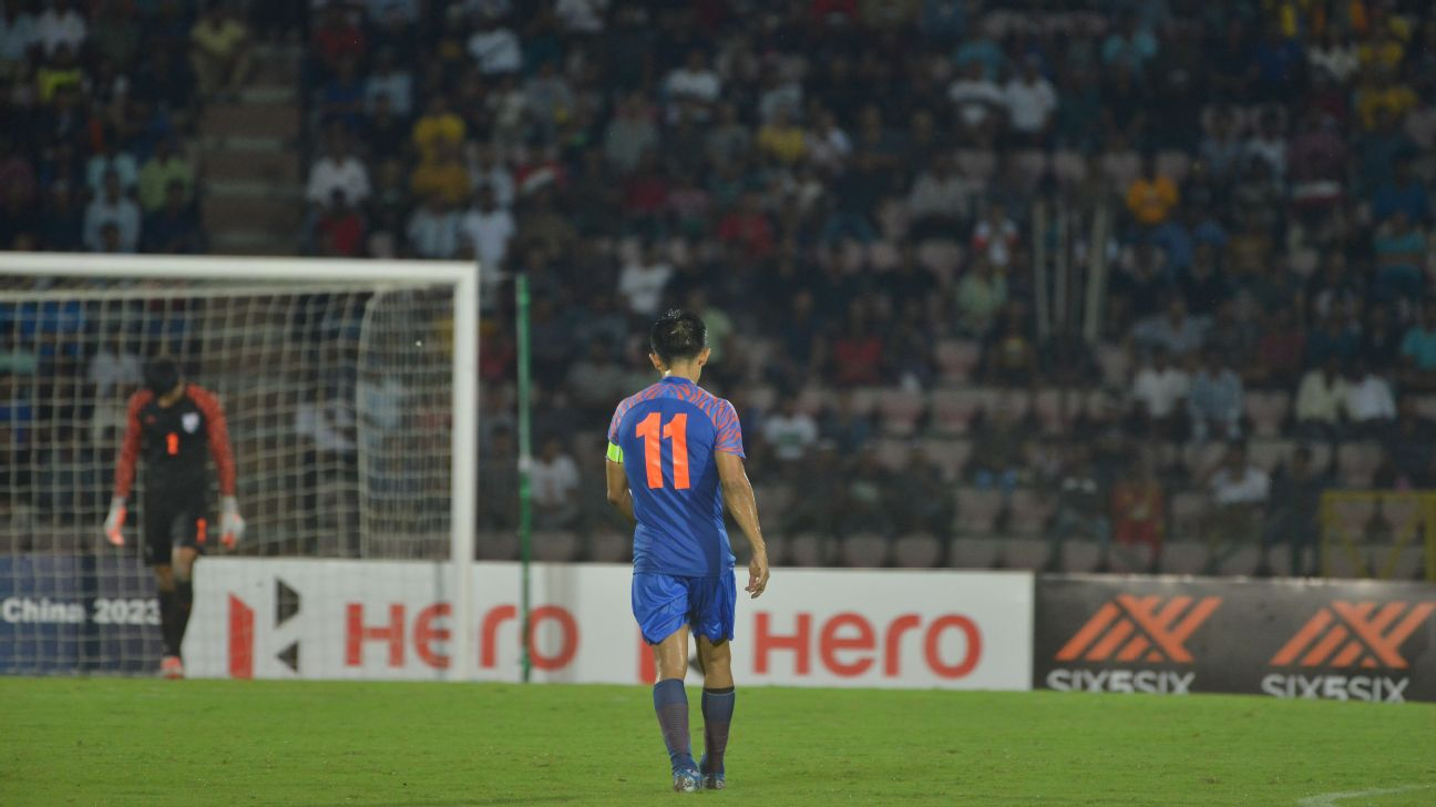 Sunil Chhetri and Gurpreet Singh Sandhu (in background) walk off disappointed after the match.