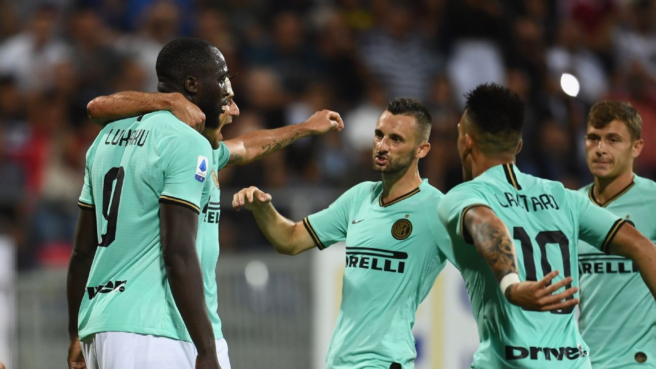 Inter Milan players celebrate with Romelu Lukaku, left, after he converted a penalty against Cagliari.