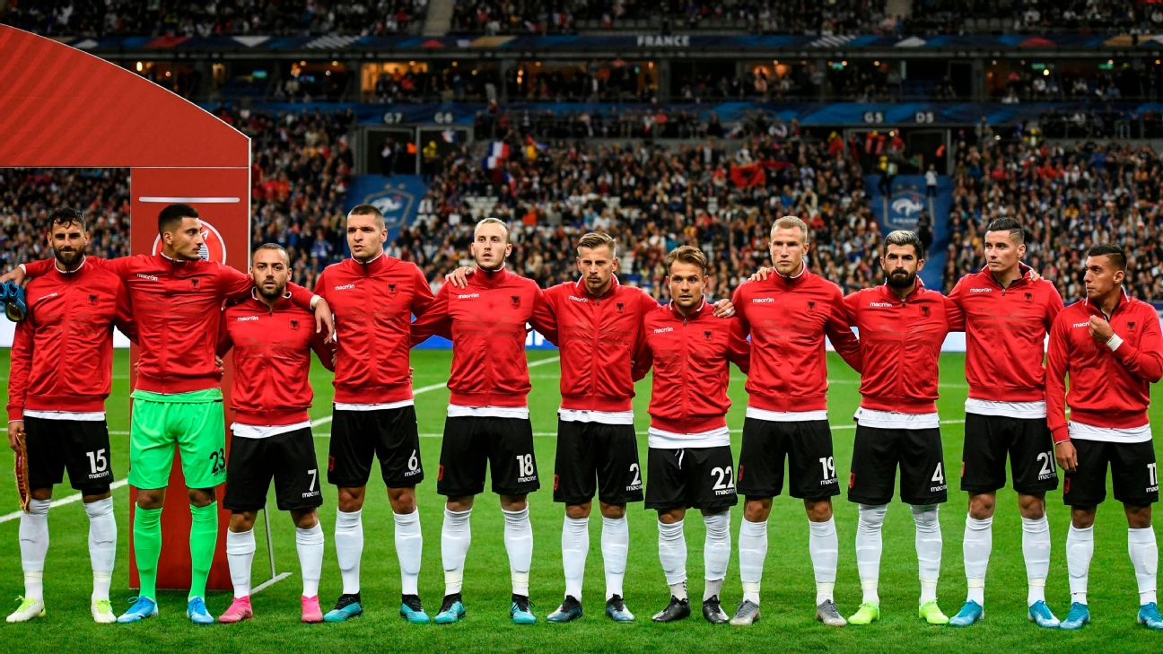 Albania players stand during the national anthem, but it is the Andorra anthem being played