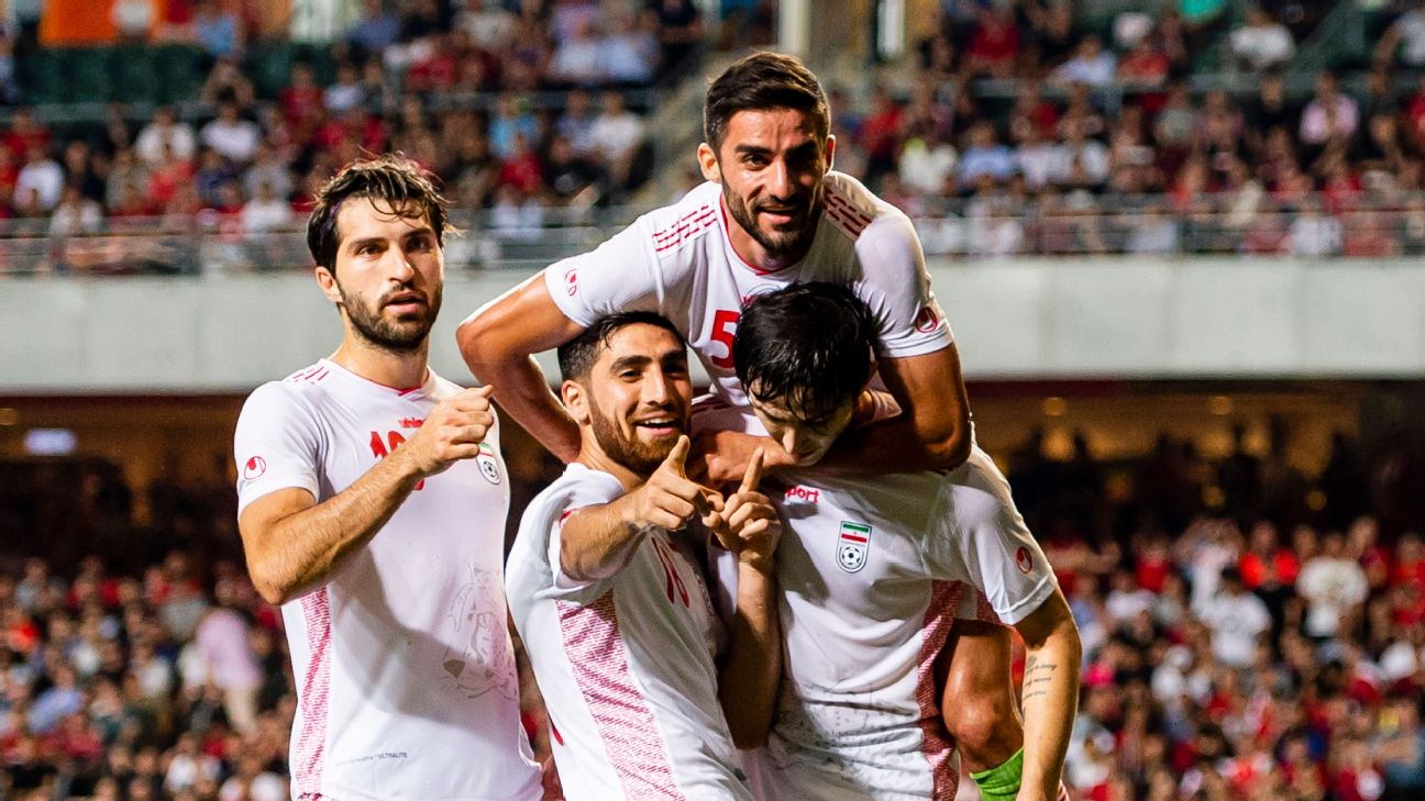 Iran players celebrate after scoring a goal against Hong Kong in Asian World Cup qualifying.