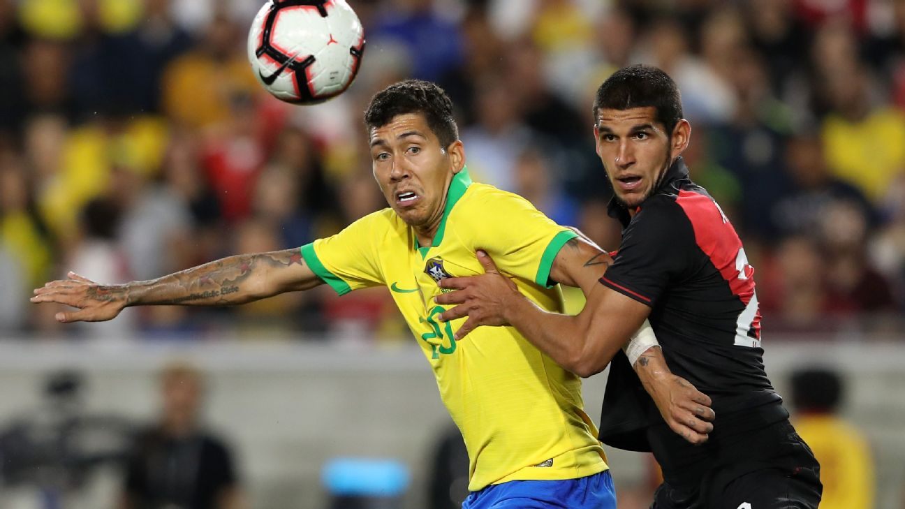 Roberto Firmino and Luis Abram