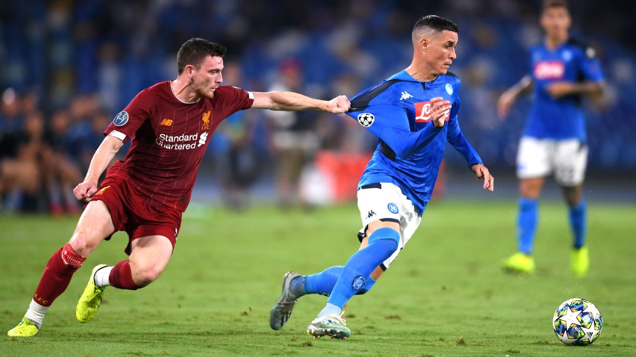 Andrew Robertson commits a foul during Liverpool's Champions League loss at Napoli