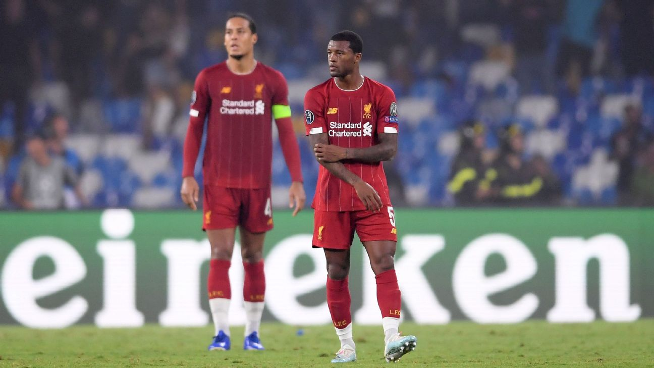 Georginio Wijnaldum and Virgil van Dijk of Liverpool react after a loss to Napoli in the Champions League.