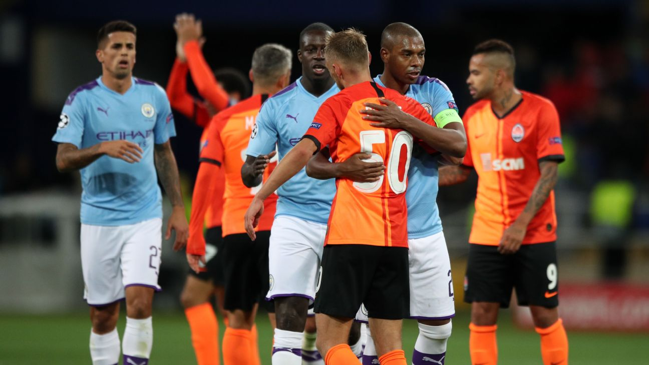 Manchester City players celebrate after their Champions League group-stage win over Shakhtar Donetsk