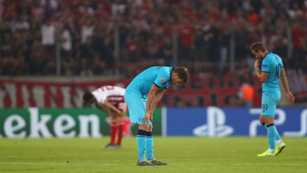 Tottenham players react after giving up a two-goal lead to draw with Olympiakos in the Champions League.