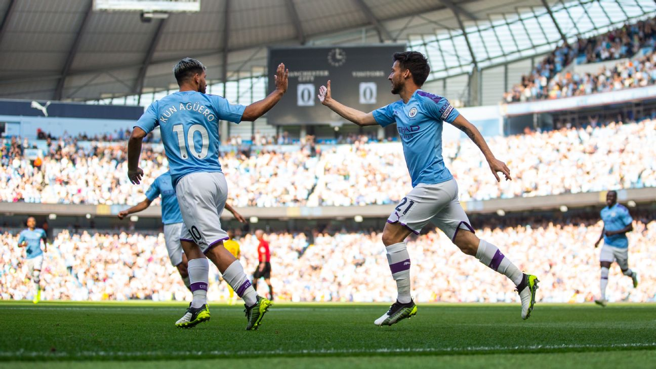 David Silva of Manchester City celebrates after scoring a goal to make it 1-0 d