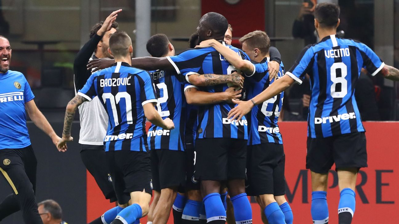 Inter players celebrate after Romelu Lukaku's goal in their Serie A win over AC Milan.