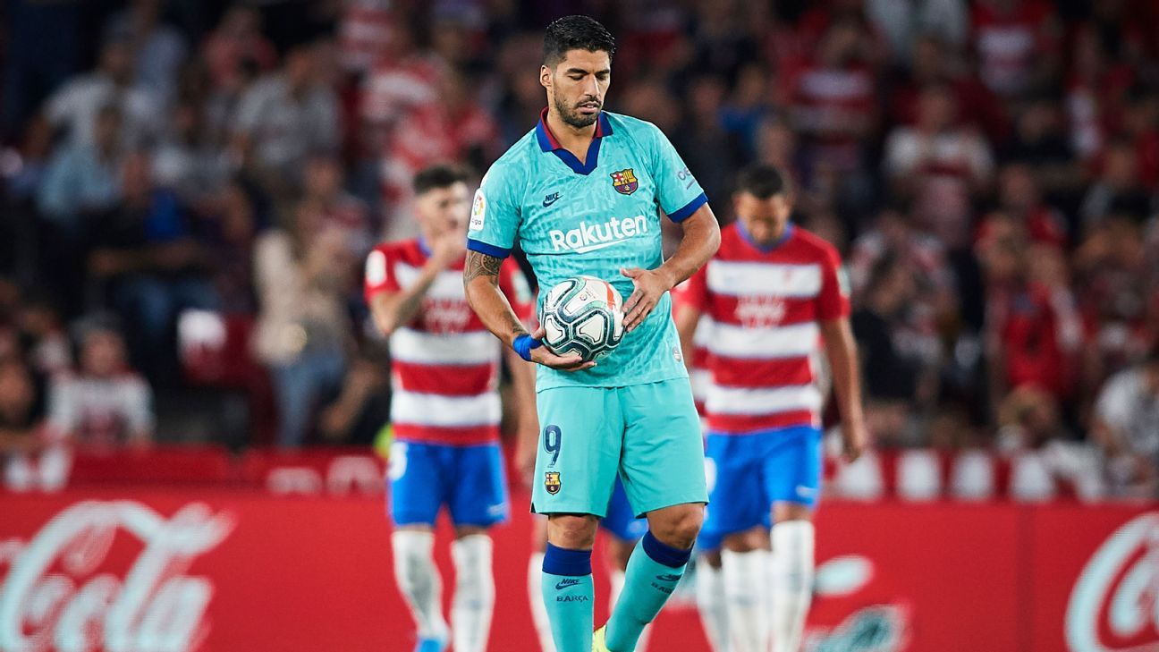 Luis Suarez looks on during Barcelona's La Liga loss to Granada.