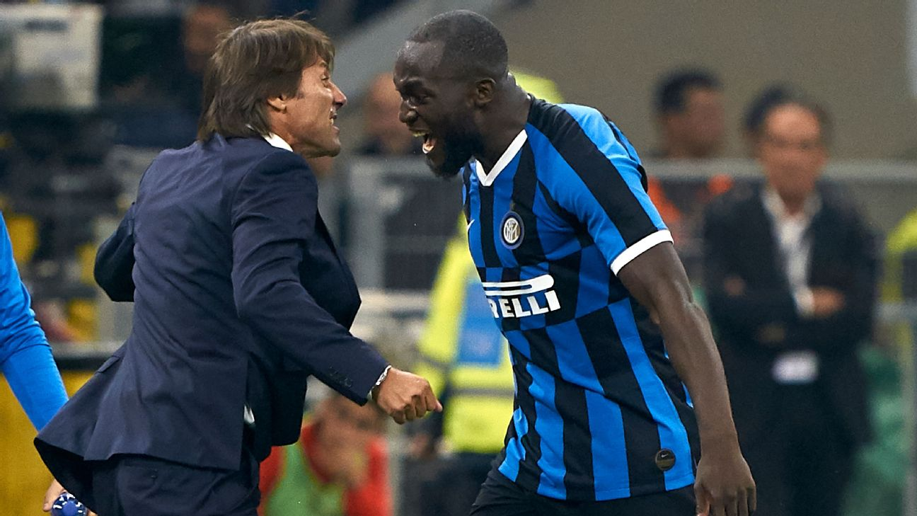 Romelu Lukaku, right, celebrates with his Inter Milan manager Antonio Conte after scoring a goal in the local derby.