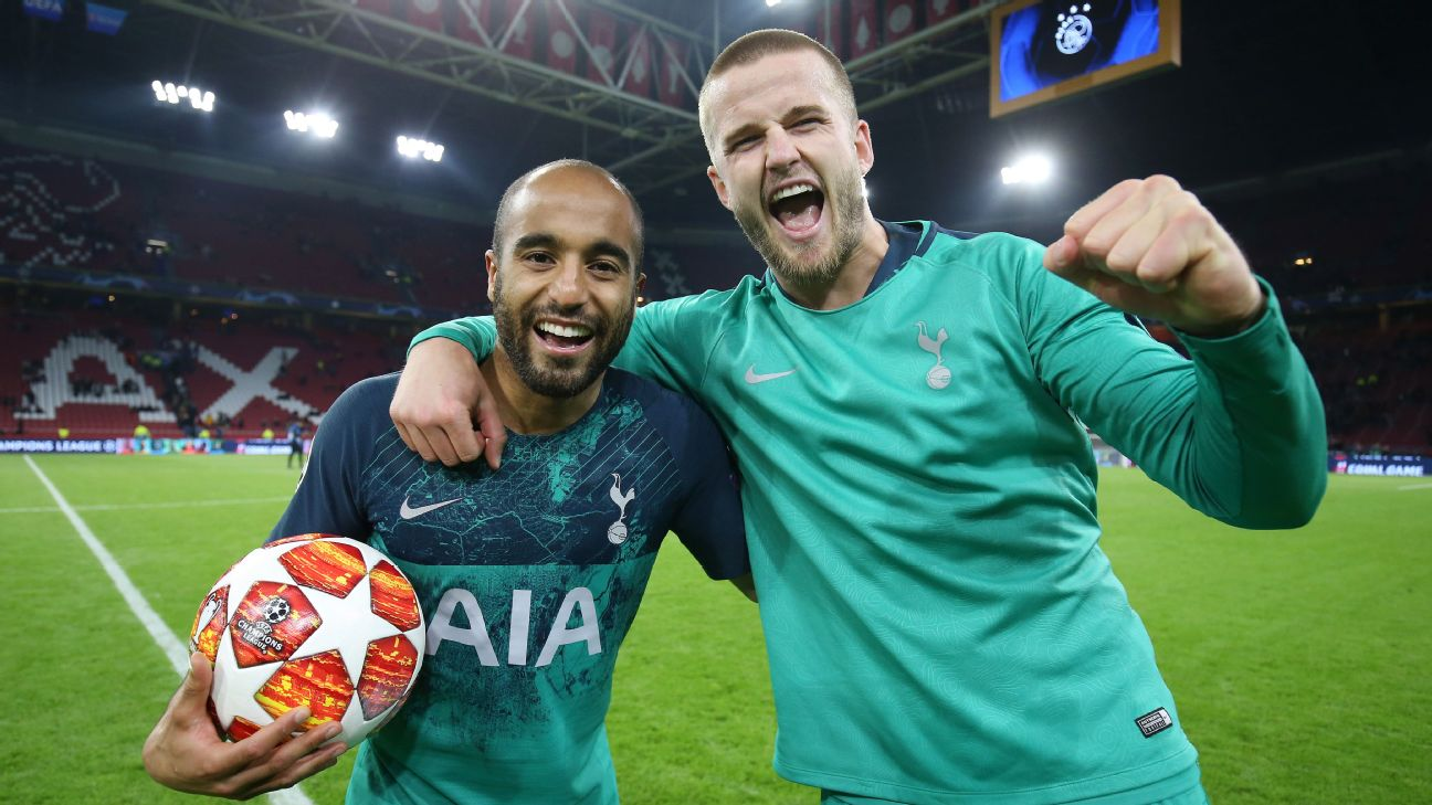 Lucas Moura of Tottenham Hotspur celebrates victory with Eric Dier