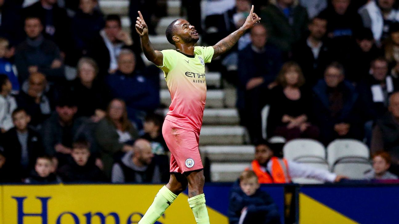 Raheem Sterling celebrates after scoring in Manchester City's Carabao Cup win at Preston North End.
