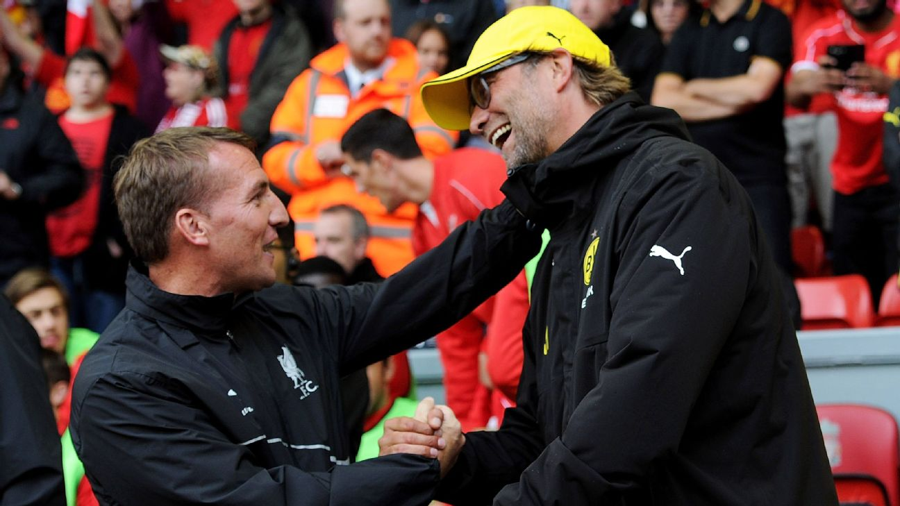 Brendan Rodgers manager of Liverpool shakes hands with Borussia Dortmund manager Jurgen Klopp