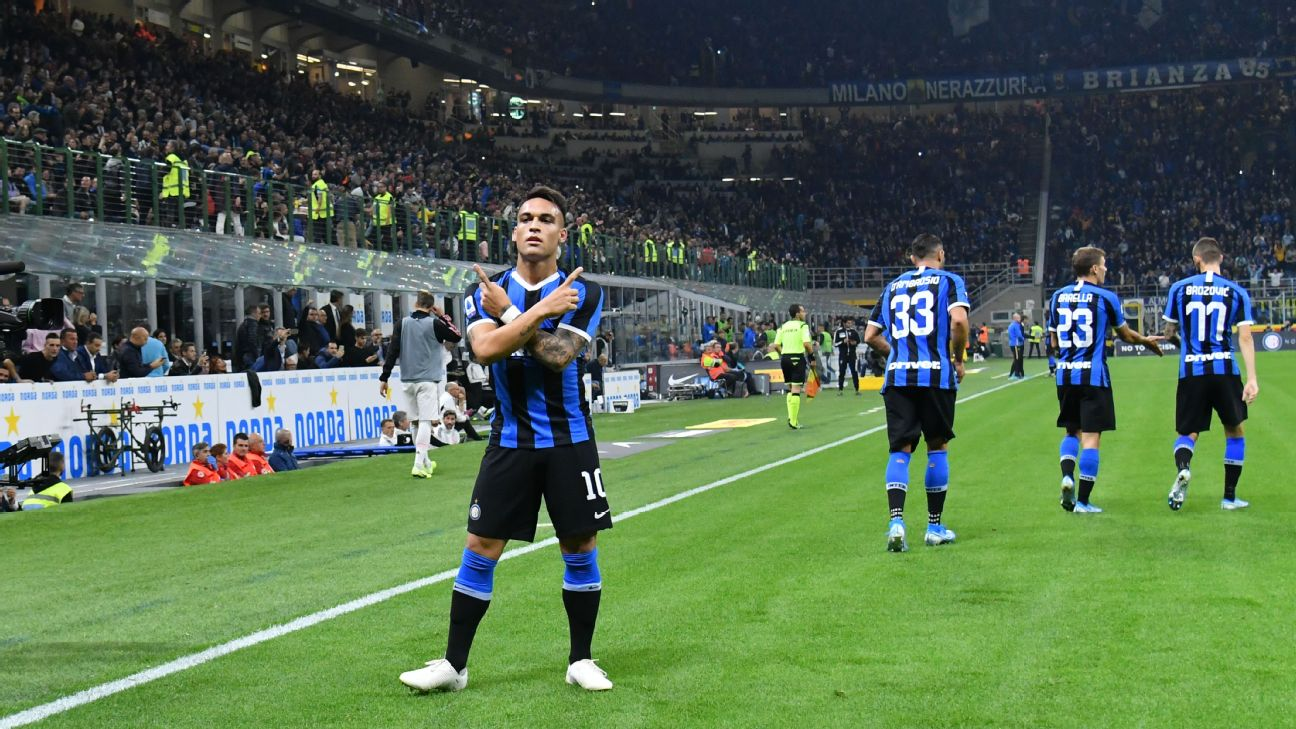 Inter's Lautaro Martinez celebrates after scoring from the penalty spot against Juventus.