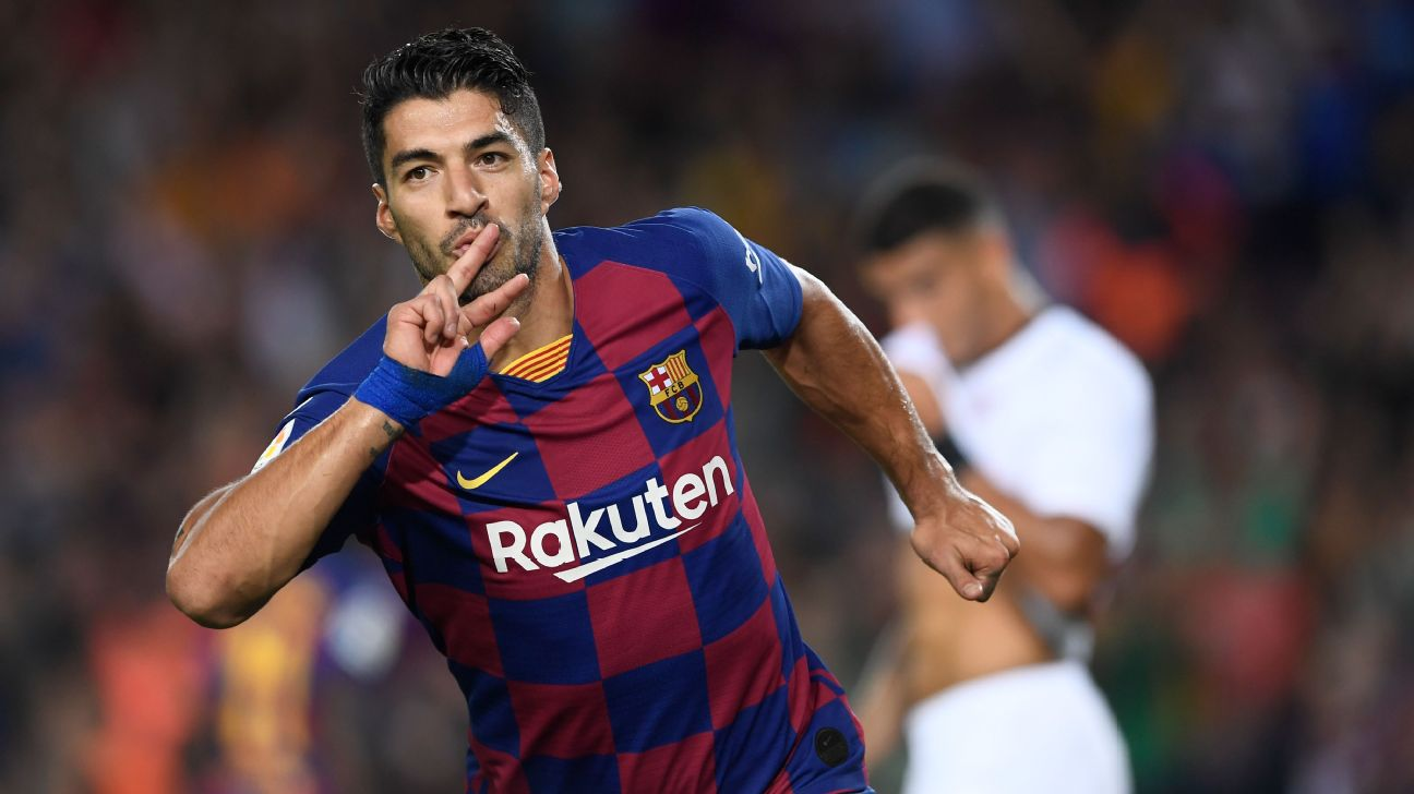 Luis Suarez celebrates after scoring a goal for Barcelona against Sevilla.