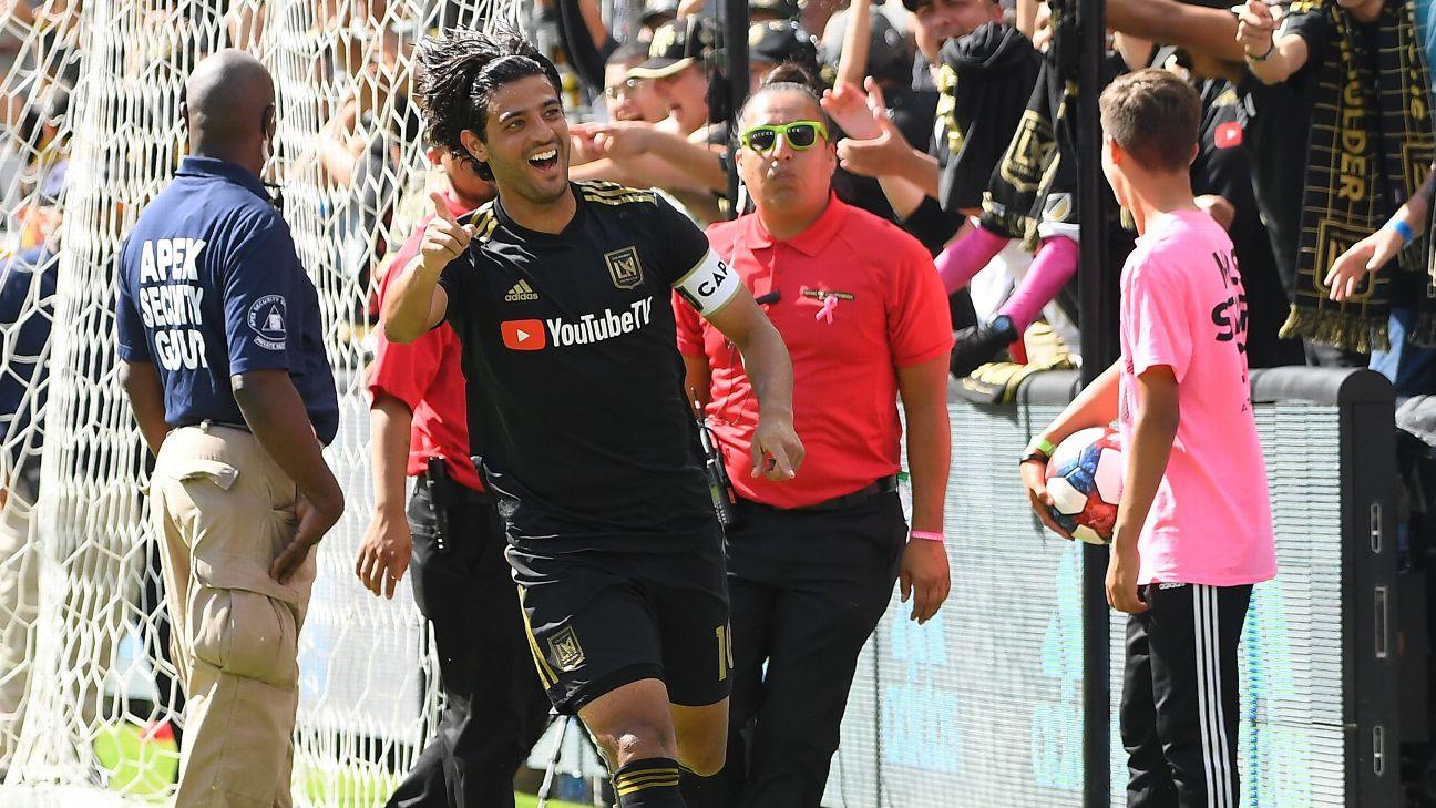 Carlos Vela celebrates after scoring in LAFC's MLS win over the Colorado Rapids.