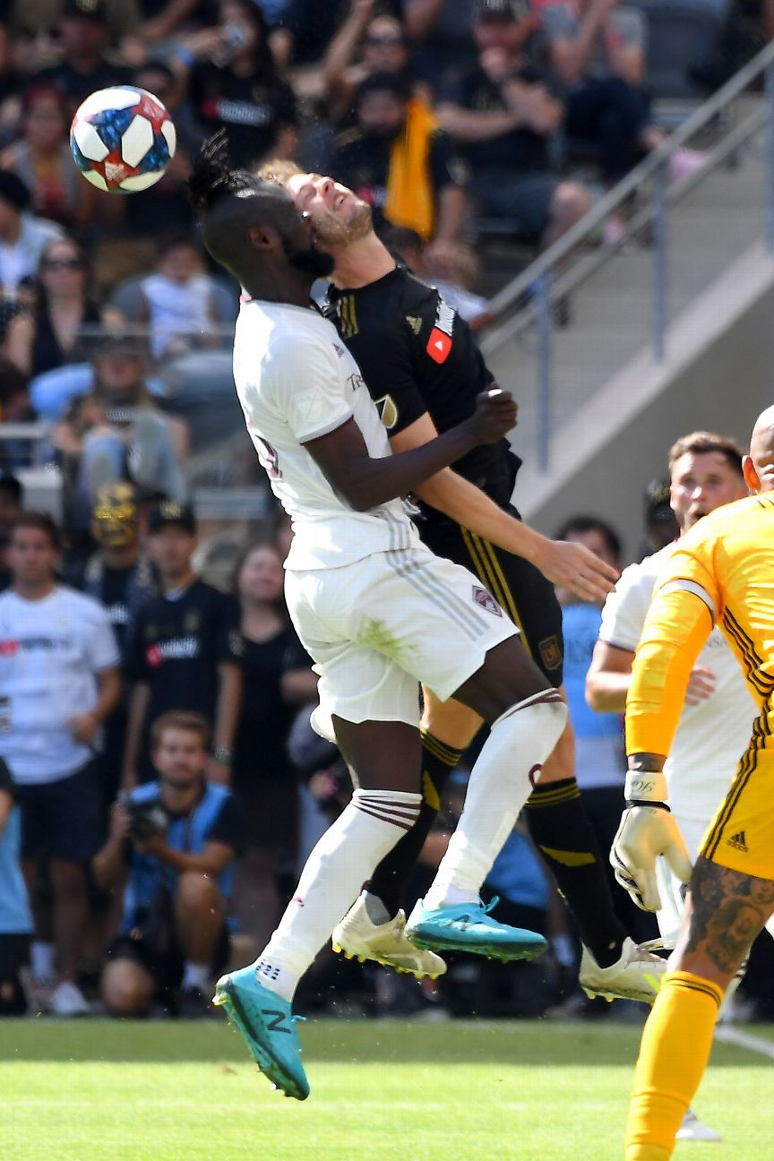 LAFC's Walker Zimmerman, right, was injured from this collision with the Colorado Rapids' Kei Kamara.