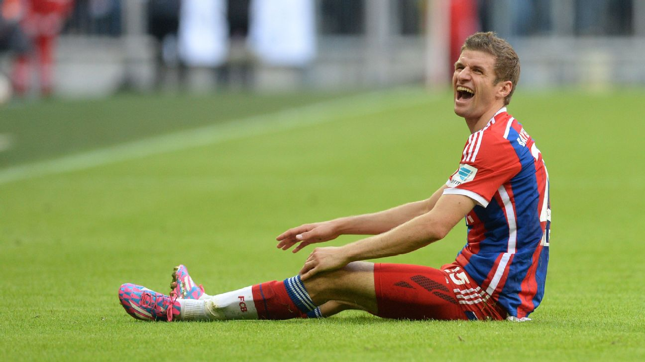 Bayern Munich's striker Thomas Mueller laughs