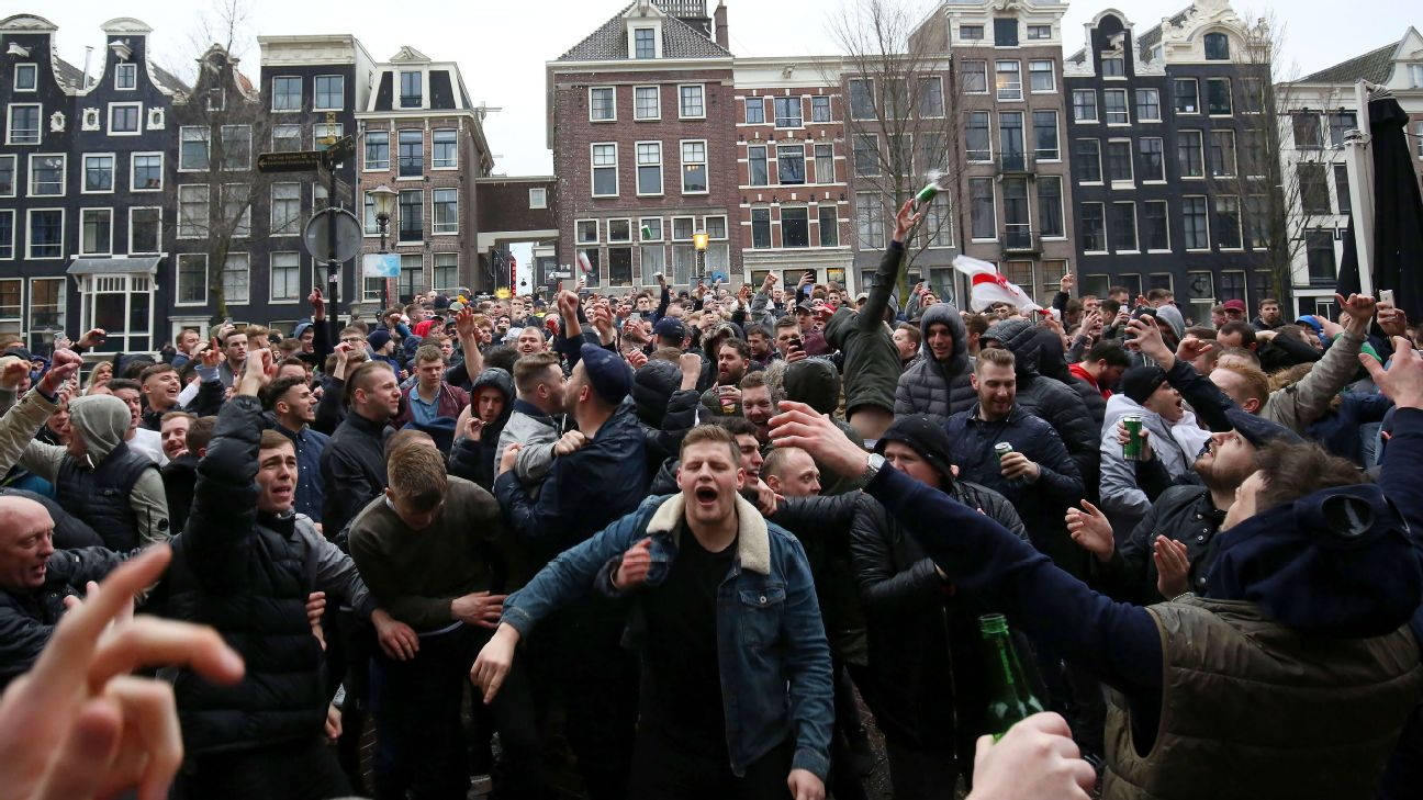 England fans party in Amsterdam before a 2018 friendly. Reports surfaced of some supporters soaking strangers in beer and throwing their property into the canals.