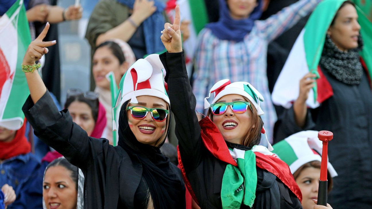 Iranian women cheer ahead of the World Cup Qatar 2022 Group C qualification football match between Iran and Cambodia
