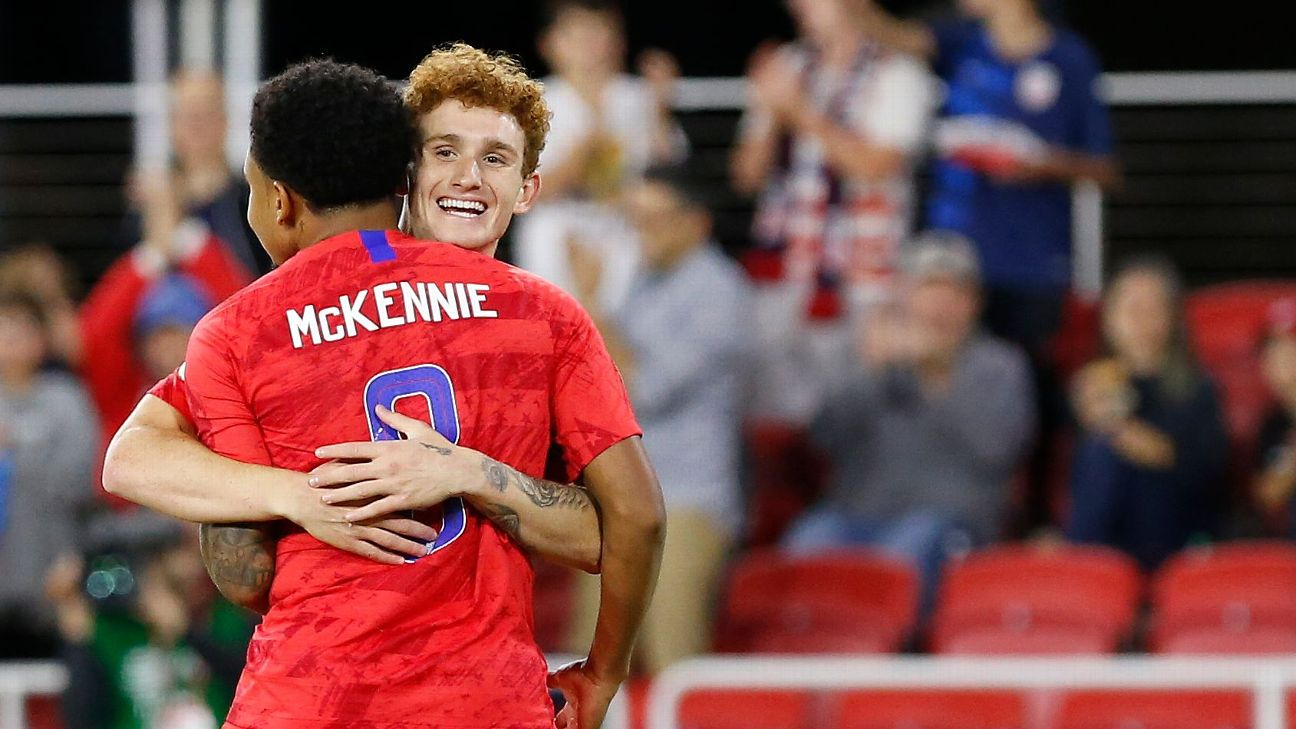 Josh Sargent celebrates with U.S. teammate Weston McKennie after scoring a goal against Cuba.