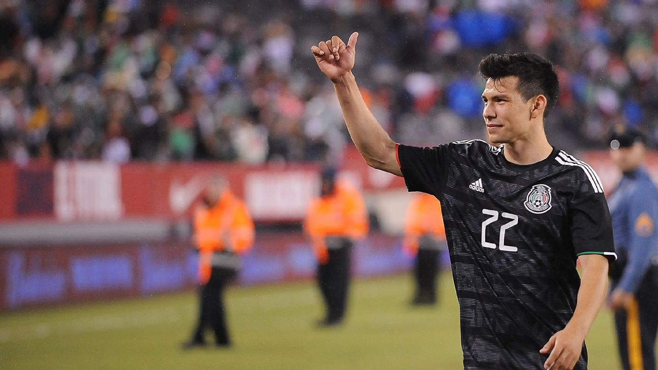 Hirving Lozano waves to the crowd after a match with the Mexico national team.
