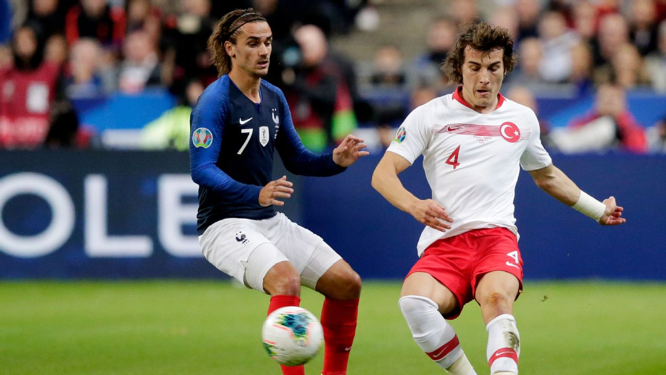 Antoine Griezmann and Caglar Soyuncu vie for the ball during the Euro 2020 qualifier between France and Turkey.