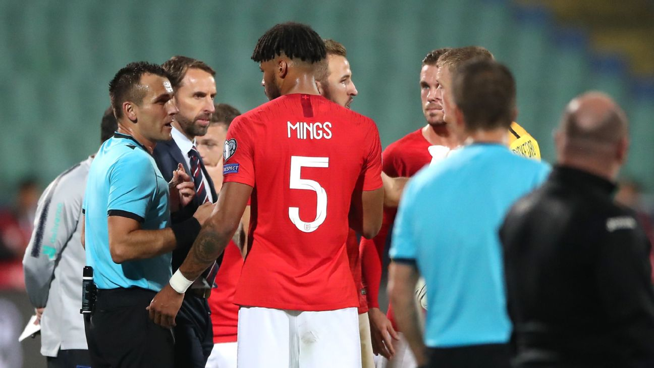 Tyrone Mings talks with the referee during England's Euro 2020 qualifier against Bulgaria.