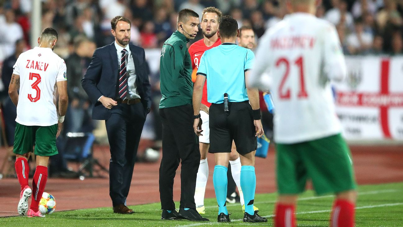 England manager Gareth Southgate confers with officials during a match stoppage against Bulgaria.