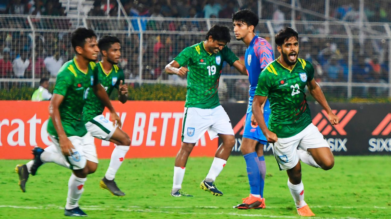 Saad Uddin (right) wheels off in celebration after putting Bangladesh 1-0 ahead in their 2022 World Cup qualifier against India in Kolkata.