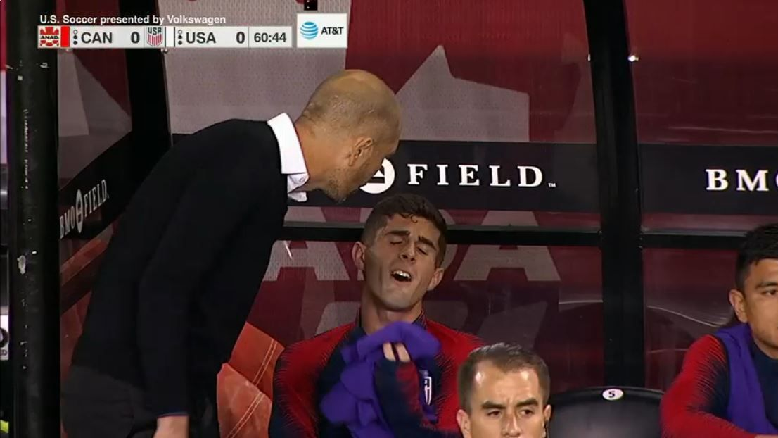 Christian Pulisic reacts on the sidelines after being subbed off in the U.S. match against Canada.