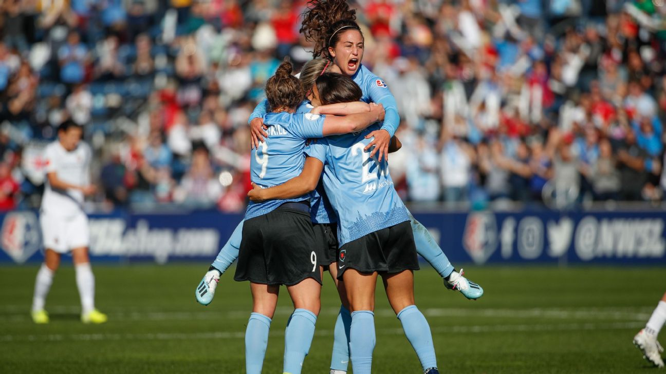 Sam Kerr celebrates with Chicago Red Stars teammates after scoring the only goal of the game in an NWSL semifinal win against the Portland Thorns.